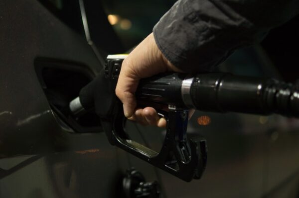 person fueling a vehicle