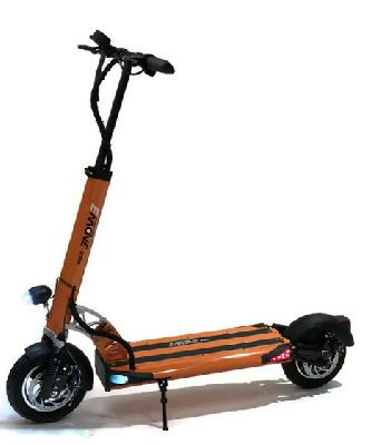 side view of an orange EMove Cruiser electric scooter with black details and two lights on side of deck turned on, leaning on its stand
