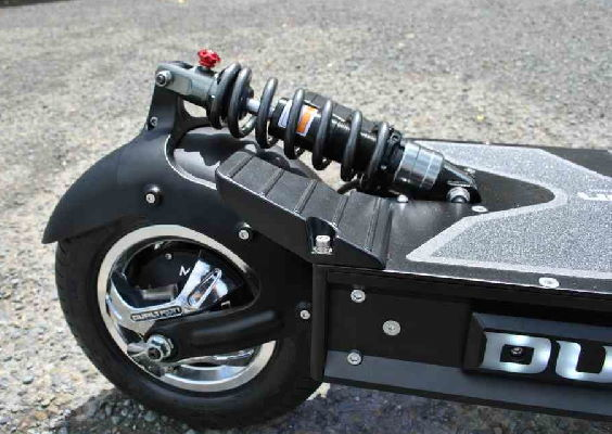 rear wheel with motor and suspension on an electric scooter