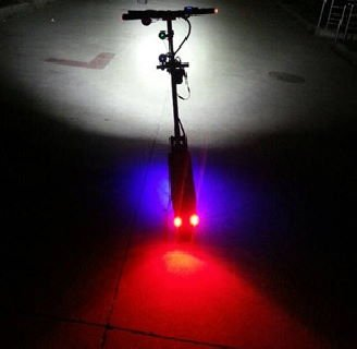 electric scooter with different lights in many colors, all turned on