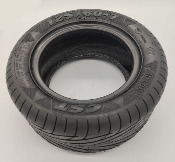 close view of a black electric scooter pneumatic tire