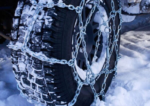 tires with chains around them for better traction in a winter environment