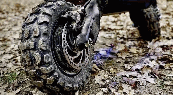 rear tire of an electric scooter in rough environment