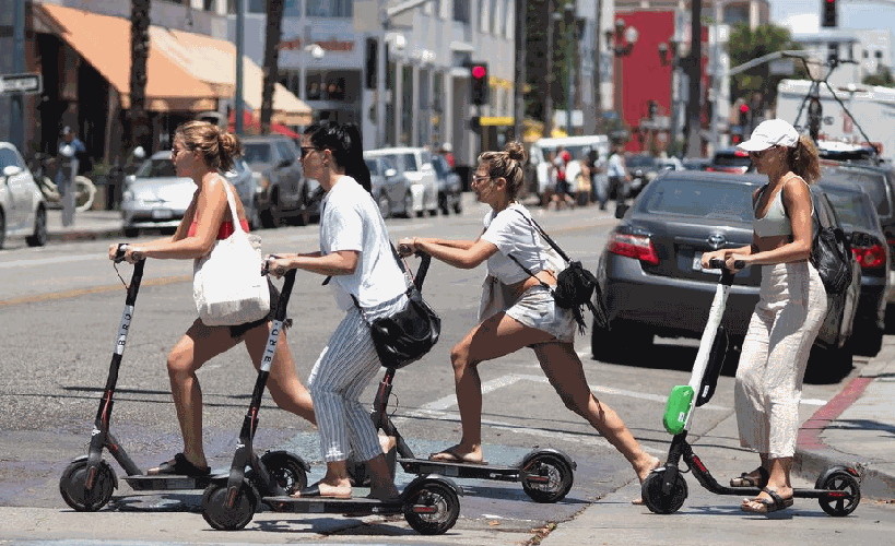 people riding electric scooters