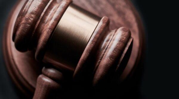 judge's hammer on a wooden platform