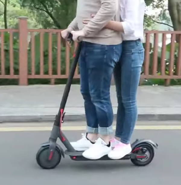 two people riding the Aovo Pro
