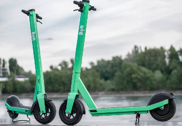two green Bolt rental electric scooters