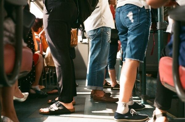 people standing in a crowded subway