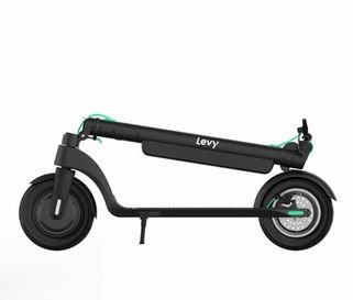 side view of a folded Levy electric scooter with green details on a white background
