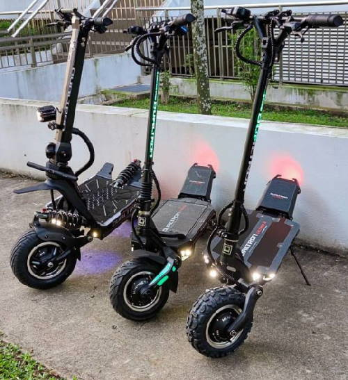 three Dualtron scooters standing one next to another - Dualtron Thunder, Dualtron Ultra, and Dualtron storm