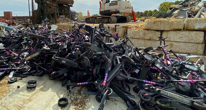 a pile of defective electric scooters
