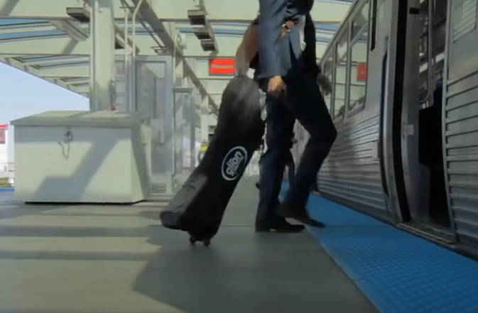person pulling a folded Glion Dolly in a bag