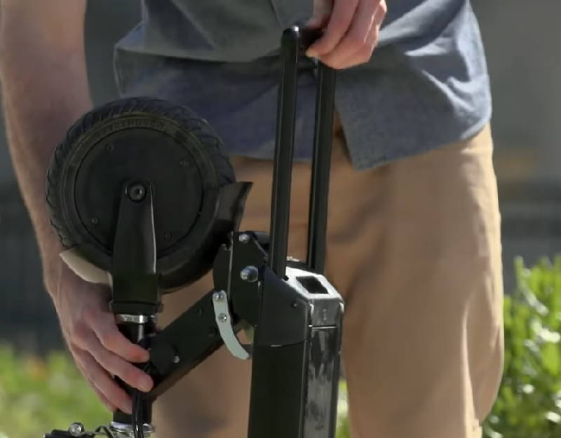 person pulling out the Dolly handle from a Glion Dolly