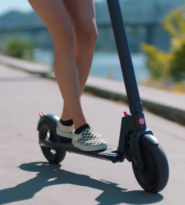 lower part of the GoTrax GXL Commuter and a person riding it