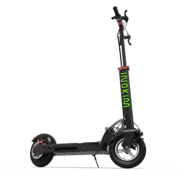 side view of a black Inokim Quick 3 Super electric scooter with green details leaning on its stand