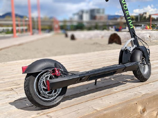 low view of the Inokim Quick 3 Super electric scooter standing on a wooden deck