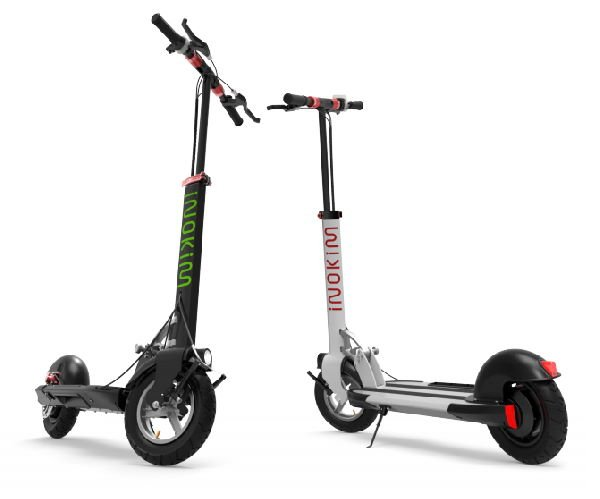 two Inokim Quick 3 Super electric scooters next to each other, first one is black with green, second one is white with red