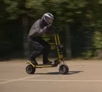 person riding fast with the Kaabo Wolf King