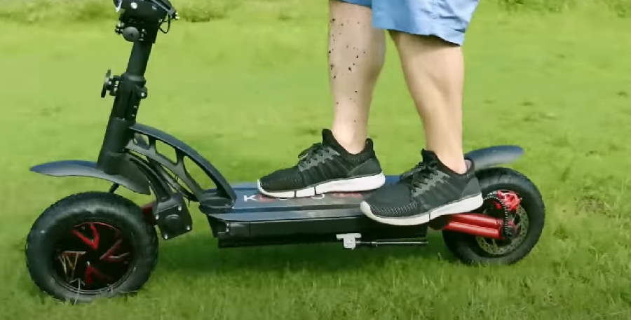 offroad riding with the Kugoo G-Booster in grass