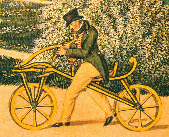 an illustration of the first velocipede model called the Laufmaschine and a person riding it