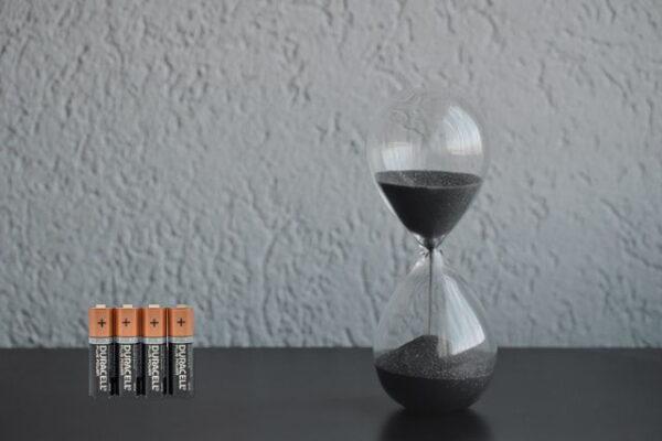 batteries next to a sand clock