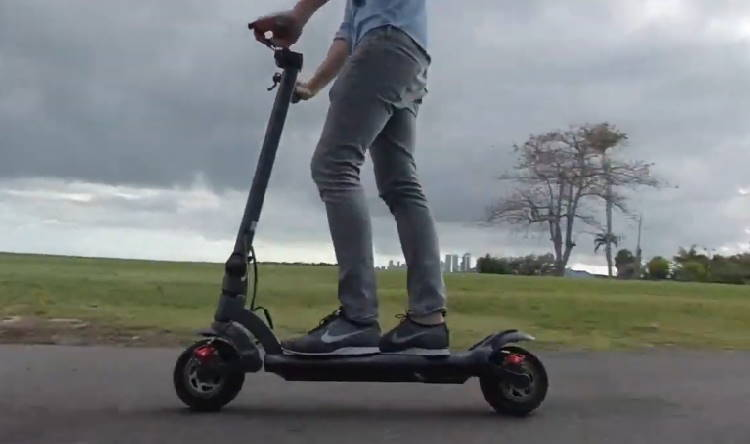 person riding the Mercane WideWheel Pro on a cloudy day