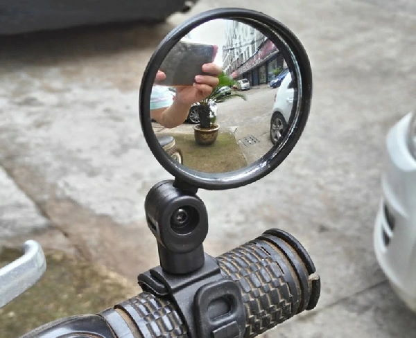 round mirror insatlled on an electric scooter handlebar