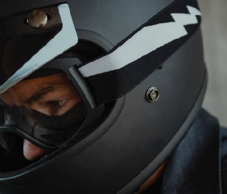 person wearing motorcycle helmet and goggles