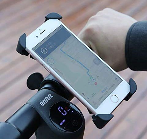 electric scooter phone holder installed on a handlebar with a phone in it