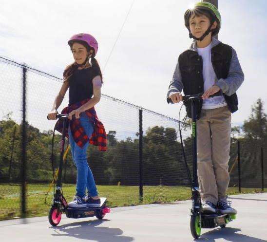 a boy and a girl riding two Razor Power Core E90s