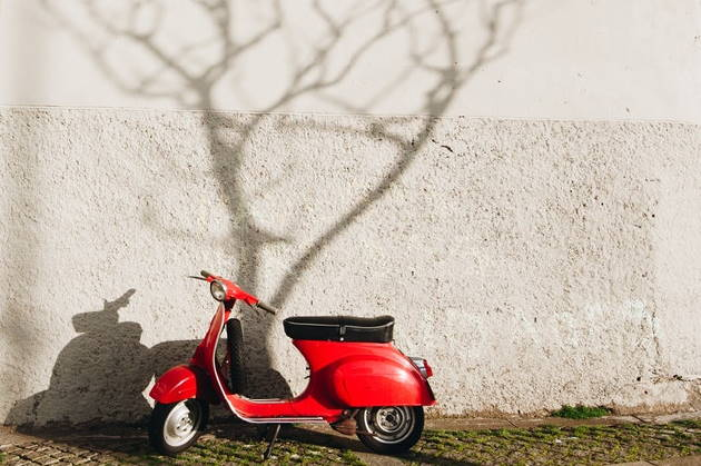 a red scooter motorcycle