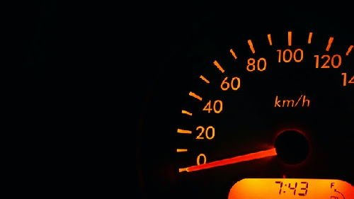 speedometer with glowing orange numbers showing 0 km/h