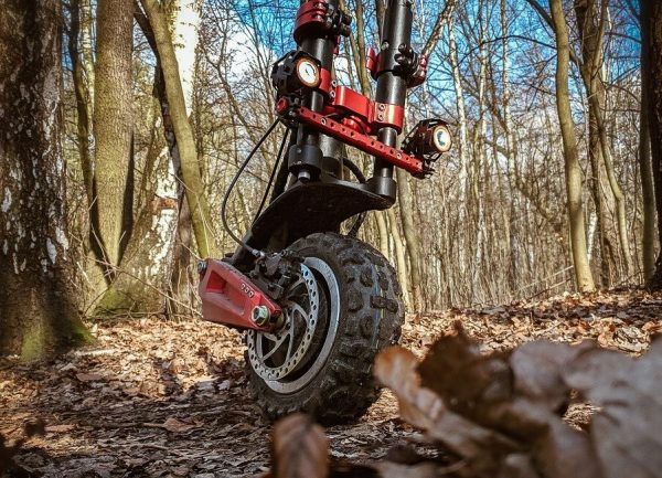 front of Techlife X9 electric scooter on a rough terrain in forrest