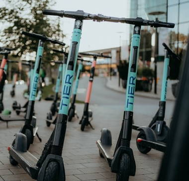 several Tier rental electric scooters