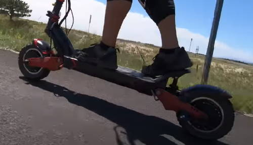 person climbing a hill with the Turbowheel Lightning