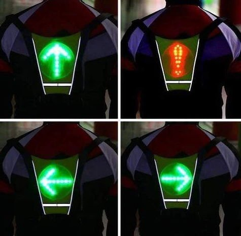 turn signal widget vest worn on the back of a person showing different signals
