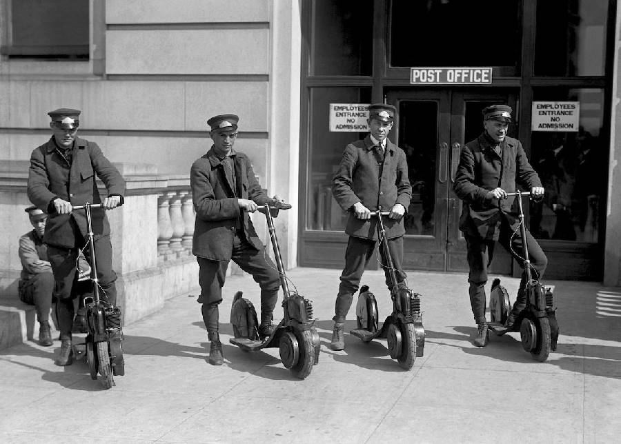 US postmen with their motorized scooters